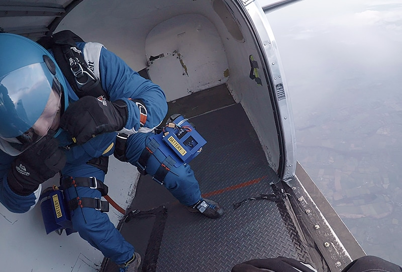 Making final adjustments seconds before jumping from 15,000ft with the thigh-mounted EDFs